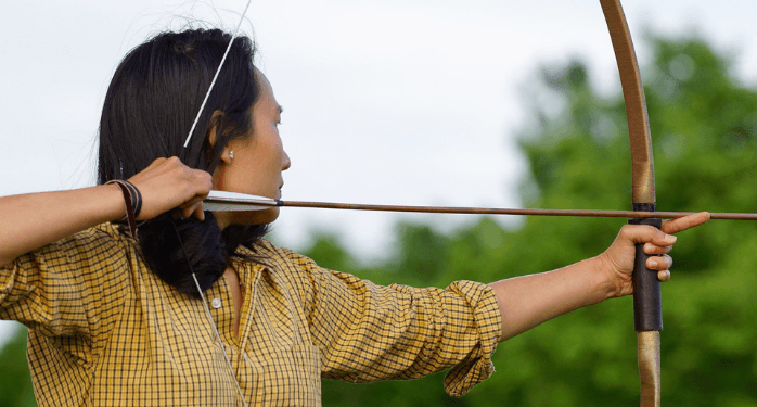 a woman with a bow and arrow