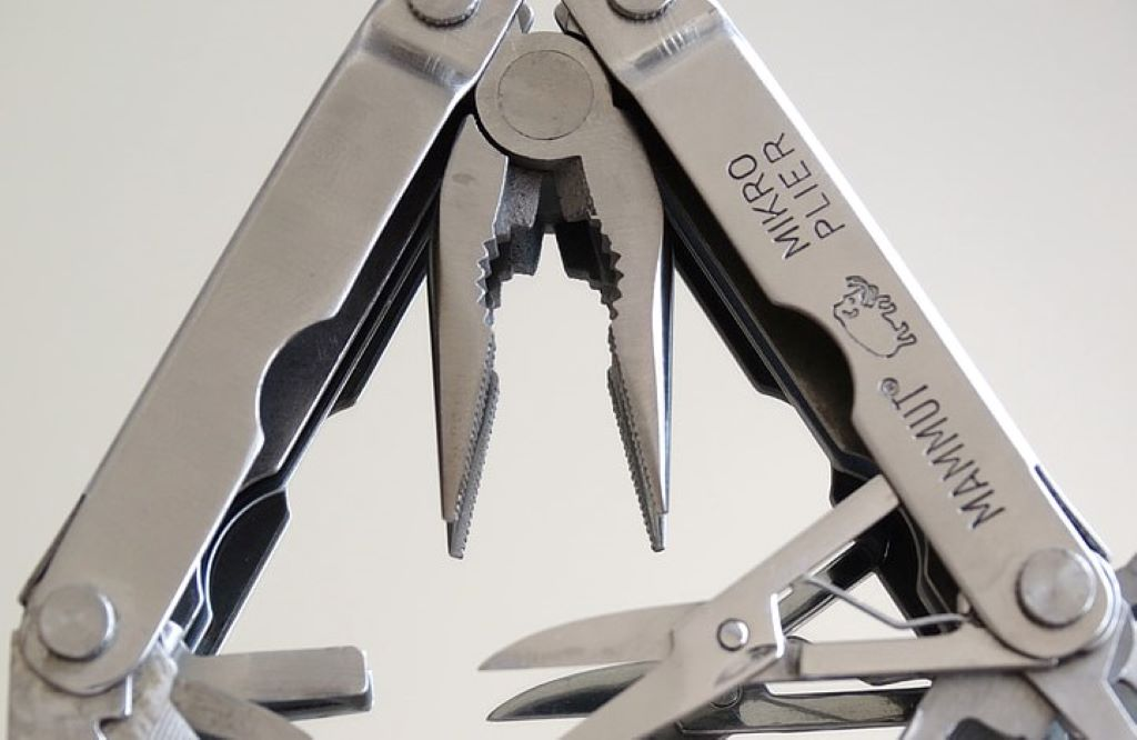 pocket tools including pliers' scissors metal chrome steel access